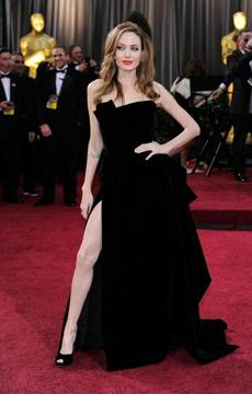 WHO: Angelina Jolie. WHERE: The 84th annual Academy Awards on Feb. 26. WORE: Atelier Versace.